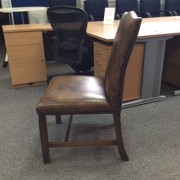 Used leather office chair side view