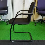 Side view of stackable visitor chair in black
