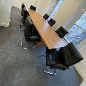 Large Walnut Boardroom Table With 8 Black Leather Meeting Chairs, Used